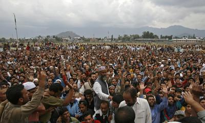 Kashmiri Muslim men shout pro-freedom slogans during funeral of youth in Srinagar