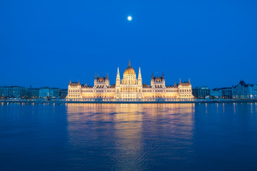 Evening view of the Hungarian Parliament Building on the bank of the Danube in Budapest, Hungary