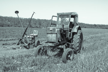 Old tractor sitting in a field