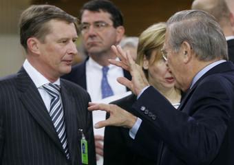 Russia's Defense Minister Ivanov and U.S. Defense Secretary Rumsfeld chat before start of 41st ...