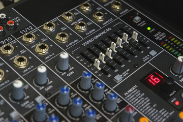 Sound equipment for a nightclub, discotheque or recording studio. The mixing console of the sound engineer in operation.