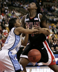 University of North Carolina's Latta strips ball from hands of University of Maryland's Langhorne during NCAA semifinal in Boston