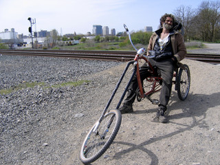 James Donaldson Jr. sits on his bicycle near homeless camp in Sacramento, California