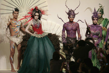 Models present creations by Chinese designer Mao Geping at China Fashion Week in Beijing