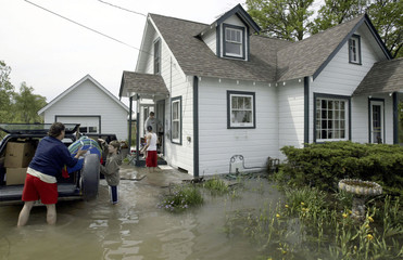 SOUTHEAST WISCONSIN RESIDENTS MOVE FROM HOME AS FLOOD WATERS FROM RAIN APPROACHES.