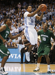 North Carolina's Larry Drew II drives to the basket against Michigan State during the first half of their NCAA basketball game in Chapel Hill