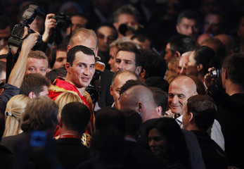 Heavyweight boxing title holder Klitschko of Ukraine walks out of ring after defeating Chagaev of Uzbekistan during IBF/WBO and IBO world heavyweight championship title fight in Gelsenkirchen