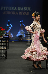 Model presents a creation from Pitusa Gasul during the International Flamenco Fashion Show in Seville