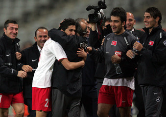 Turkey's Sahin celebrates his goal against Germany while hugging head coach Terim during their soccer game in Istanbul