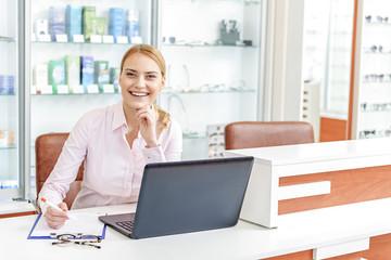 Joyful glance of store worker