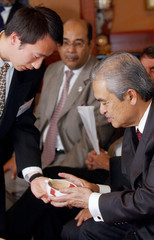 Malaysian Prime Minister Abdullah Ahmad Badawi is shown a model of a human eye in Sydney.