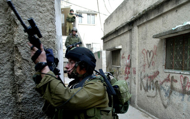 Israeli soldiers aim their rifles during clashes in Balata refugee camp