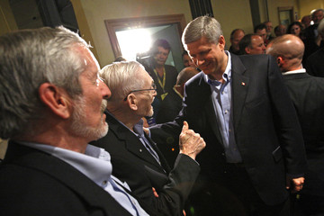 Conservative leader and Canada's PM Harper greets supporters during a campaign rally in Courtenay