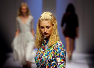 Models wear designs by Australian designer Elizabeth Findlay under the label 'Zambesi' during a ...