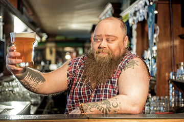 Happy male drinking glass of beer