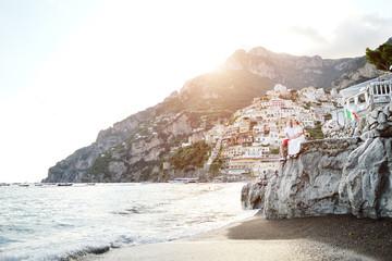 Happy young couple in honeymoon in Positano, Amalfi Coast, Italy