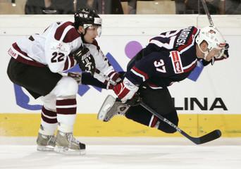 Latvia's Sorokins trips Parrish of the U.S. at the World Ice Hockey Championship in Innsbruck, Austria.