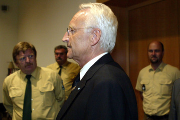 BAVARIAN STATE PREMIER STOIBER ENTERS COURTROOM IN AUGSBURG.