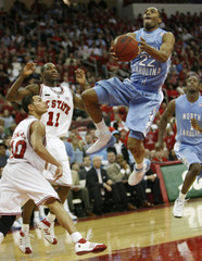 University of North Carolina's Ellington drives to the basket past the defense of North Carolina State University in Raleigh
