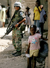 UN peacekeepers stand guard outside polling station in Gonaives