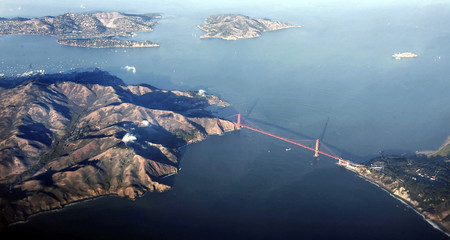 -PHOTO TAKEN 04NOV05- San Francisco's Golden Gate Bridge is seen in this aerial photo at sunset Nove..