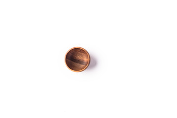 Dark wooden bowl on a white background from top