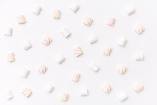 Pattern sweet marshmallow, candy on white background, top view flat lay. Isolated minimal concept above decoration, view white marshmallow, food background