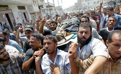 Mourners shout anti-Israeli slogans during funeral of slain Islamic Jihad militant Mohammed Abdel Al in Rafah