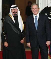 U.S. President Bush poses with Saudi Arabia's King Abdullah upon arrival at White House in Washington