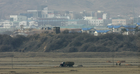 Farm tractor moves along road in Gijungdong propaganda village in this picture taken from South Korean observation post at truce village of Panmunjom in Paju
