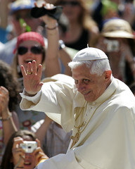Pope Benedict waves to the faithful during his weekly Wednesday general audience in St. ...