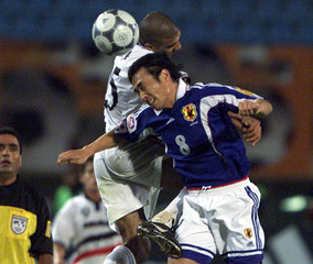 MOCHIZUKI OF JAPAN JUMPS WITH IRAQ'S ABOUHEIL IN QUARTERFINALS OF ASIAN CUP IN BEIRUT.