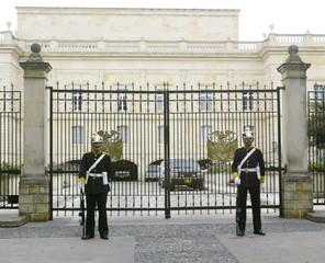 COLOMBIAN PRESIDENTIAL STAND GUARD IN FRONT AT NARINO PALACE.