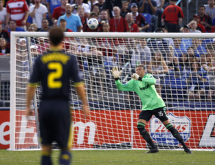 AC Milan's goalkeeper Zeljko Kalac keeps his eyes on the ball as a shot by Chelsea's Didier Drogba crosses toward the goal during first half of World Football Challenge soccer match in Baltimore
