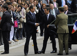 French President Sarkozy is welcomed by Spain's Prime Minister Zapatero at the Moncloa Palace in Madrid