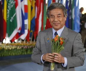 Japanese Foreign Minister Nakasone receives a bunch of tulips upon his arrival at the World Forum Conference Centre in The Hague