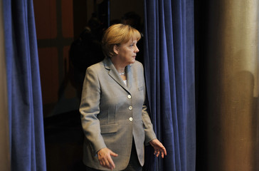 Merkel arrives for a group session at the summit at the G20 Summit on Financial Markets and the World Economy at the National Building Museum in Washington