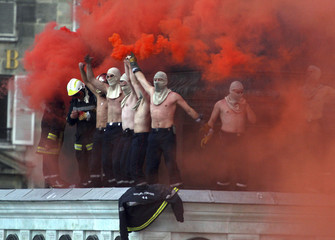 Firemen demonstrate for better working conditions and retirement rights, at Place de la Bastille in Paris