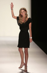 U.S.designer Nicky Hilton waves after her Nicholai's Spring/Summer 2008 collection show in Mexico City
