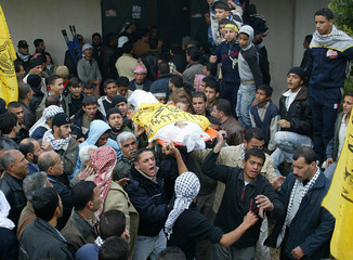 Men carry the body of Osama Nassar during his funeral in Gaza