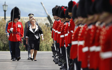 Chile's President Bachelet inspects the guard before a meeting with Canada's Governor General Michaelle Jean at the Citadelle in Quebec City