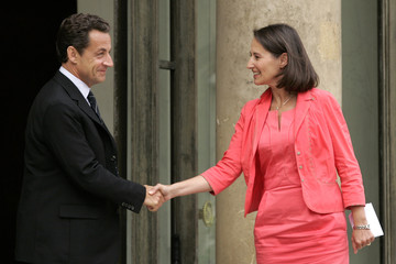 France's President Nicolas Sarkozy shakes hands with Segolene Royal as she leaves the Elysee Palace in Paris