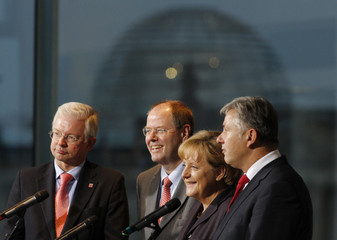 German Chancellor Merkel Hesse's Prime Minister Koch German Finance Minister Steinbrueck and Berlin mayor Wowereit  attend a news conference in the Chancellery in Berlin