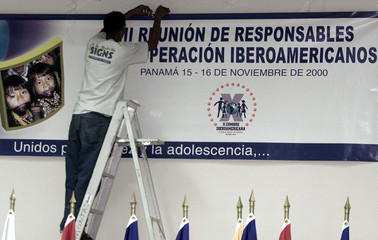 A PANAMANIAN WORKS IN THE LATE PREPARATIONS FOR NEXT WEEKEND'S IBEROAMERICAN SUMMIT.