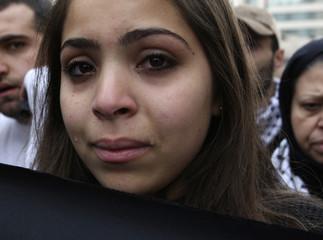 A Jordanian woman cries during a demonstration against the Israeli air strikes in the Gaza Strip in Amman
