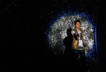 Taiwan singer Jay Chou performs during his concert in Taipei