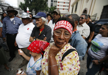 Supporters of ousted Honduran President Manuel Zelaya stand outside congress in Tegucigalpa