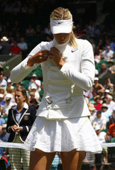 Maria Sharapova of Russia arrives on Centre Court before her match against Gisela Dulko of Argentina at the Wimbledon tennis championships in London