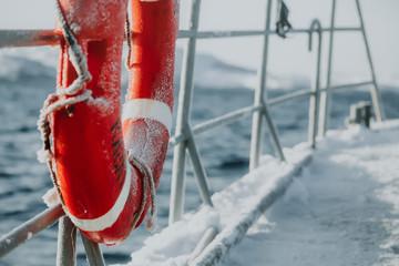 Wall Mural - Fishing ship is swimming at sea at winter