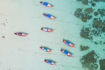Aerial view over group of long tail boats,Top view from drone, Koh Lipe island, Satun,Thailand